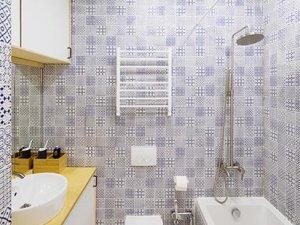 35㎡简约单身公寓卫生间图片 布纹砖卫浴装修效果图